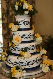 Classic black and white cake with beautiful yellow flowers