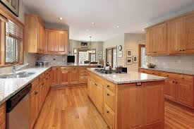 awesome kitchen with light wood cabinets and ceiling lighting