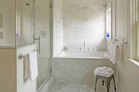Tiling A Bathtub Deck by Marble Clad Bathtub With Marble Subway Tiles Transitional Bathroom
