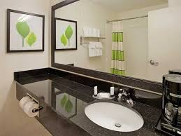 Guest Bathroom Wall Decor With Framed Picture Above Single Sink Vanity