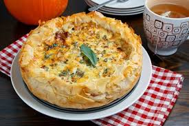 Preparing Fresh Pumpkin For Pies by Roasted Pumpkin Quiche With Caramelized Onions Gorgonzola And