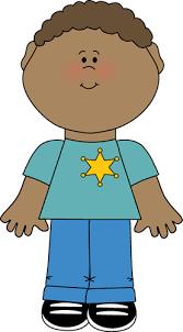 Boy wearing a sheriff s badge