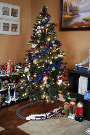The Leg Of Tree Is Looking A Little Bare So Well Add Classic Lego Train Set Carrying Passengers Back Home For Christmas