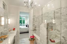 walk in shower with gray and white marble beveled subway tiles