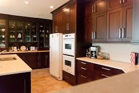 White Tile Floor With Appliances Small U Shaped Kitchen Idea