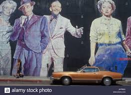 Famous Mural Artists Los Angeles by Old Car In Front Of A Mural Painting Showing Famous Actors At