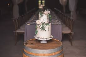White Wedding Cake With Fresh Flowers Leaves And Branches