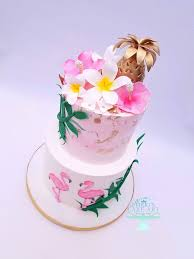 This Hawaiian Themed Wedding Cake Features A Golden Pineapple Plumerias Hibiscus Flowers And Flamingos