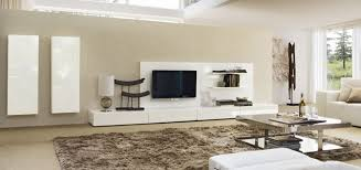 modern living room with glossy metal coffee table white tv stand