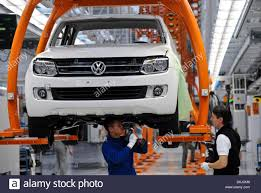 VW Employees Work On A The Assembly Line For The Volkswagen Pickup ... Best Diesel Engines For Pickup Trucks The Power Of Nine Salo Finland August 1 2015 Ford Super Duty F250 Pickup Truck New Gmc Denali Luxury Vehicles And Suvs Tagged Truck Gear Linex Humps The Bumps Racing Line Ep 12 Youtube Fords 1st Engine In 1958 Chrysler Cporation Resigned Its Line Trucks With Vw Employees Work On A Assembly Volkswagen Benefits Owning Miami Lakes Ram Blog Yes Theres Mercedes Heres Why San Diego Chevrolet Sale Bob Stall Pickups 101 Busting Myths Aerodynamics