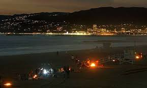 Fire Rings Line Dockweiler State Beach In Los Angeles With Santa Monica Across The Bay