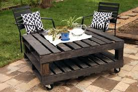 Outdoor Wood Pallet Furniture Coffee Table With Truckle And Metal Framed Garden Chair