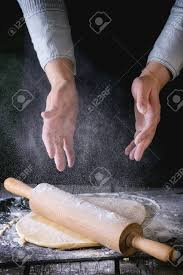 Dark Rustic Style Female Hands Powdered By Flour Rolled Out Dough For Pasta With Wooden Rolling Pin Over