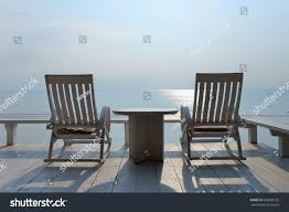 Two Rocking Chairs By Sea Huahin Stock Image | Download Now Costway Outdoor Rocking Lounge Chair Larch Wood Beach Yard Patio Lounger W Headrest 1pc Fniture For Barbie Doll Use Of The Kids Beach Chairs To Enhance Confidence In Wooden Folding Camping Chairs On Wooden Deck At Front Lweight Zero Gravity Rocker Backyard 600d South Sbr16 Sheesham Relaxing Errecling Foldable Easy With Arm Rest Natural Brown Finish Outdoor Rocking Australia Crazymbaclub Lovable Telescope Casual Telaweave