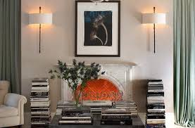 wall sconce lighting living room transitional with stacked books