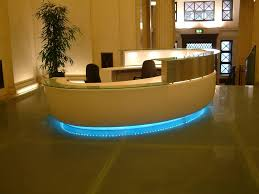 Extraordinary Hotel Interior Schemes Involving Round Shape For Modern Reception Desk Design Ideas With Mesmerize Floor Lamps To Adorn It