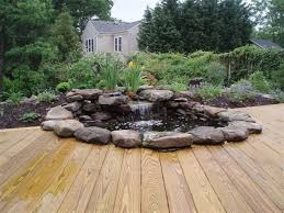 Aquascape Patio Pond Australia by Waterfall Pond With Wood Stained Deck Contemporary Patio Dc