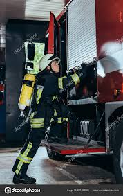 Side View Female Firefighter Fire Extinguisher Back Closing Truck ... Quickrelease Fire Extinguisher Safety Work Truck Online Acme Cstruction Supply Co Inc Equipment Jeep In Az Free Images Wheel Retro Horn Red Equipment Auto Signal Lego City Ladder 60107 Creativehut Grosir Fire Extinguisher Truck Gallery Buy Low Price Types Guide China 8000l Sinotruk Foam Powder Water Tank Time Transport Parade Motor Vehicle Howo Heavy Rescue Trucks Sale For 42 Isuzu Fighting Manufacturer Factory Supplier 890