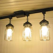jar track lighting fixture trio with vintage quarts