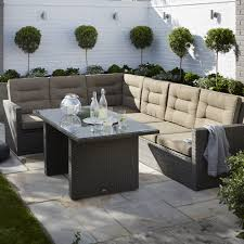 Liking The Planting Behind Seating Area Kington Rattan Effect 7 Seater Dining Set