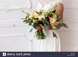 Bride Holding A Bouquet Of Flowers In Rustic Style Wedding With The White Room
