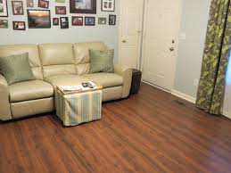 Installing Laminate Floors On Walls by Flooring Awesome Leather Sofa With Wall Art For Home Depot