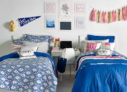 Simple Symmetrical Arrangement Of Dorm Room Ideas For Two With A Small Desk Between Beds