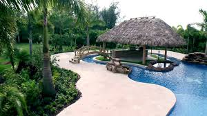 Backyard Tiki Hut Oasis Video | DIY Tiki Hut Builder Welcome To Palm Huts Florida Outdoor Bench Kits Ideas Playhouse Costco And Forts Pdf Best Exterior Tiki Hut Cstruction Commercial For Creating 25 Bbq Ideas On Pinterest Gazebo Area Garden Backyards Impressive Backyard Patio Quality Bali Sale Aarons Living Custom Built Bars Nationwide Delivery Luxury Kitchen Taste Build A Natural Bar In Your For Enjoyment Spherd Residential Rethatch