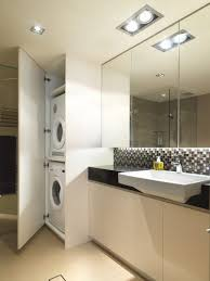 small bathroom with laundry inside cabinet badezimmer
