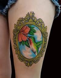 Colored Hummingbird Thigh Tattoos