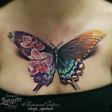 Open Wing Butterfly And Flowers Tattoo On Lower Back