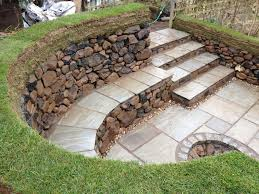 Diy Stone Fire Pit With Seating | Dry Stone Seating Area And Fire ... Fire Pits Is It Safe For My Yard Savon Pavers Best 25 Adirondack Chairs Ideas On Pinterest Chair Designing A Patio Around Pit Diy Gas Fire Pit In Front Of Waterfall Both Passing Through Porchswing 12 Steps With Pictures 66 And Outdoor Fireplace Ideas Network Blog Made How To Make Backyard Hgtv Natural Gas Party Bonfire Narrow Pool Hot Tub Firepit Great Small Spaces In
