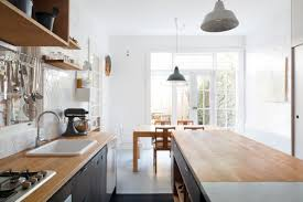 Above Designed For Two Academics One Of Whom Is A Dedicated Baker And Cook The Kitchens Central Island Offers Generous Counter Space Making Homemade