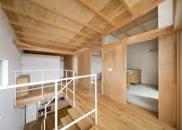100 Exposed Joists House In Mikage Contrasts White Surfaces With Exposed Wooden
