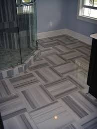 porcelain cararra floor tile with glass accents in master bathroom