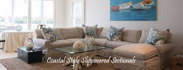 slipcovered sectional sofa in traditional white color slipcover