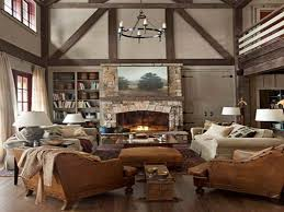 Round Iron Chandelier Over Brown Fabric Couch Set And Stone Fireplace Mantel Also Built In Book Cabinet