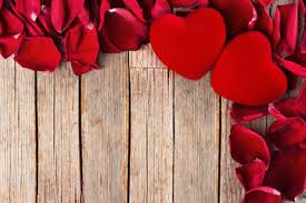 Valentines Day Background Red Hearts And Petals On Rustic Wooden Table
