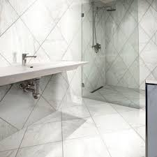 carrara marble look porcelain tile in stand up shower