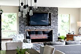 Transitional Style Family Room With Rustic And Industrial Ledgestone Fireplace Reclaimed Wood Edison Bulbs Decor