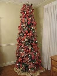 A Decorated 7 1 2 Foot Slim Christmas Tree