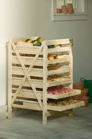 the homestead survival build a vertical food storage rack for