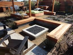 custom concrete seating bench around gas firepit traditional fire