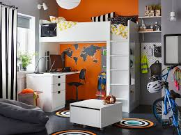 A Black Grey Orange And White Bedroom For Child In Their Pre