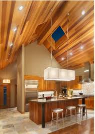 kitchen with wooden vaulted ceiling and recessed lights and