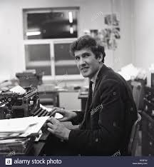 1964 Historical A Male Newspaper Reporter At His Work Desk Using Typewriter To
