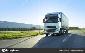Front-View Of Semi Truck With Cargo Trailer Driving On A Highway ...