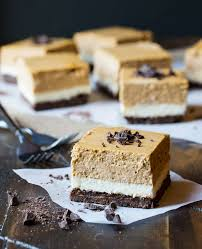 Pumpkin Swirl Cheesecake Bars by 18 Easy Pumpkin Cheesecake Recipes How To Make Pumpkin Cheesecake