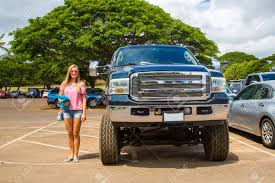 100 Ford Monster Truck Huge In Comparison To A Young Lady On The Stock