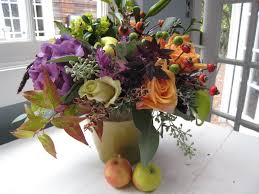 Surprising Colorful Flowers With Ceramic Vase And Two Apples At White Clothes Table Plus Christmas